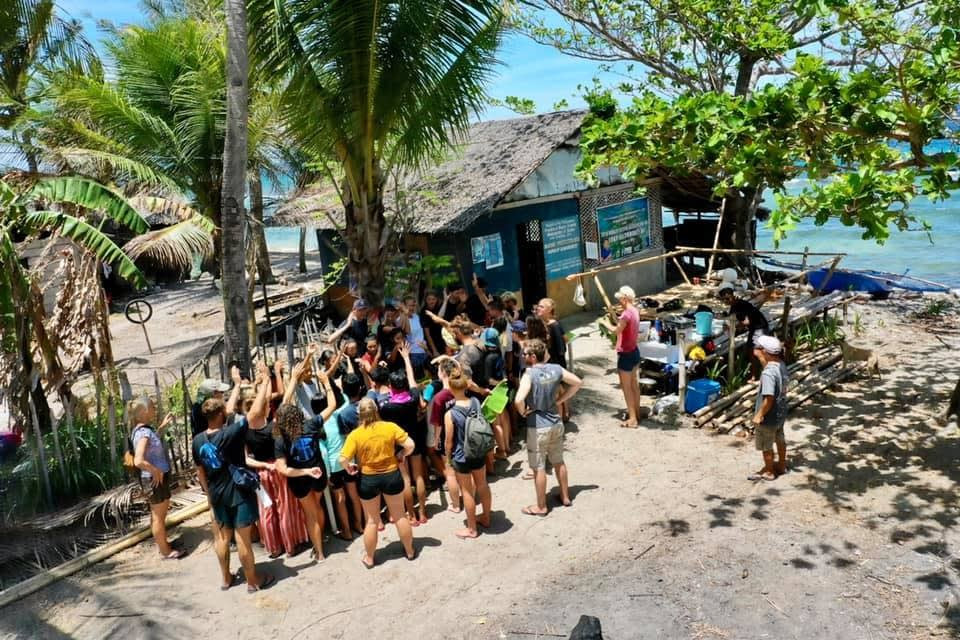 Volunteers and kids gathering at the guardhouse